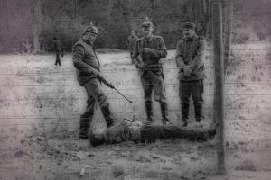 Belgische acteurs spelen de Duitse grenswacht na.